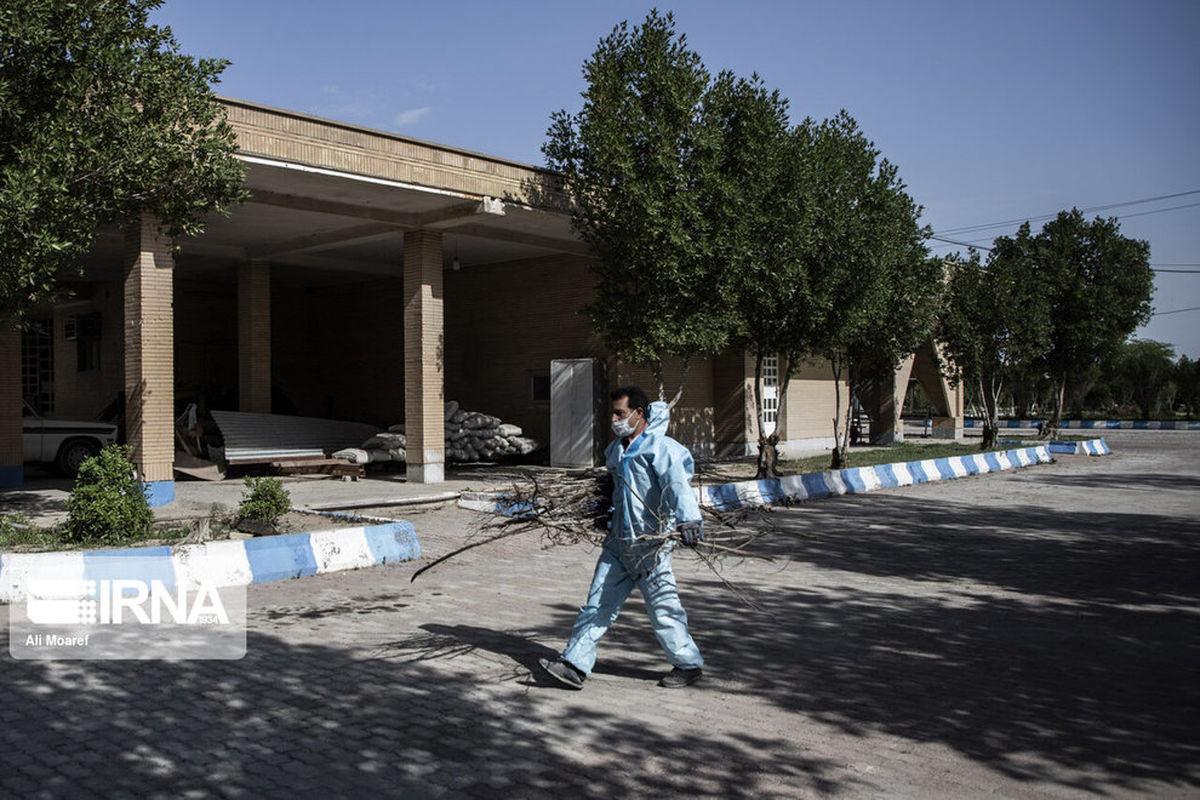 خاکسپاری فوتیهای کرونا در آرامستان اهواز+عکسها
