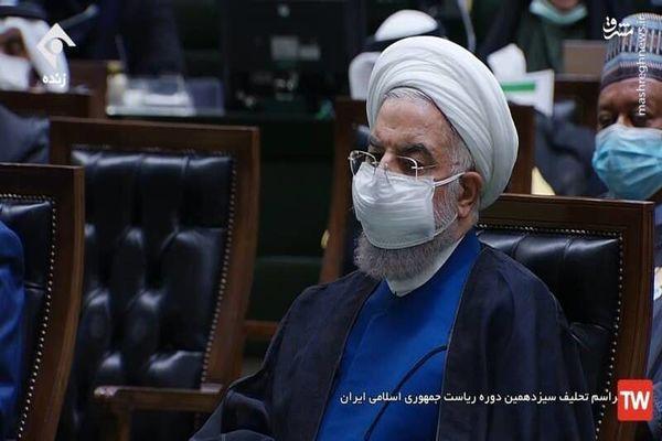 روحانی با صورت اخمو به مجلس رفت