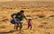 تصویر کودک پناه اورده به تکاور ارتش ایران